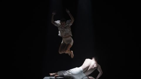 One dance is jumping mid air above a second dancer who is lying on the floor, attempting to get up. From Brink, 2020, commissioned by Maiden Voyage Dance Company. Photo Credit Luca Truffarelli