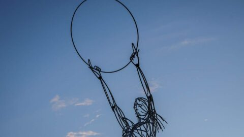 Beacon Of Hope, Belfast. Metal sculpture of female figure holding aloft a circle. Courtesy of Tourism NI