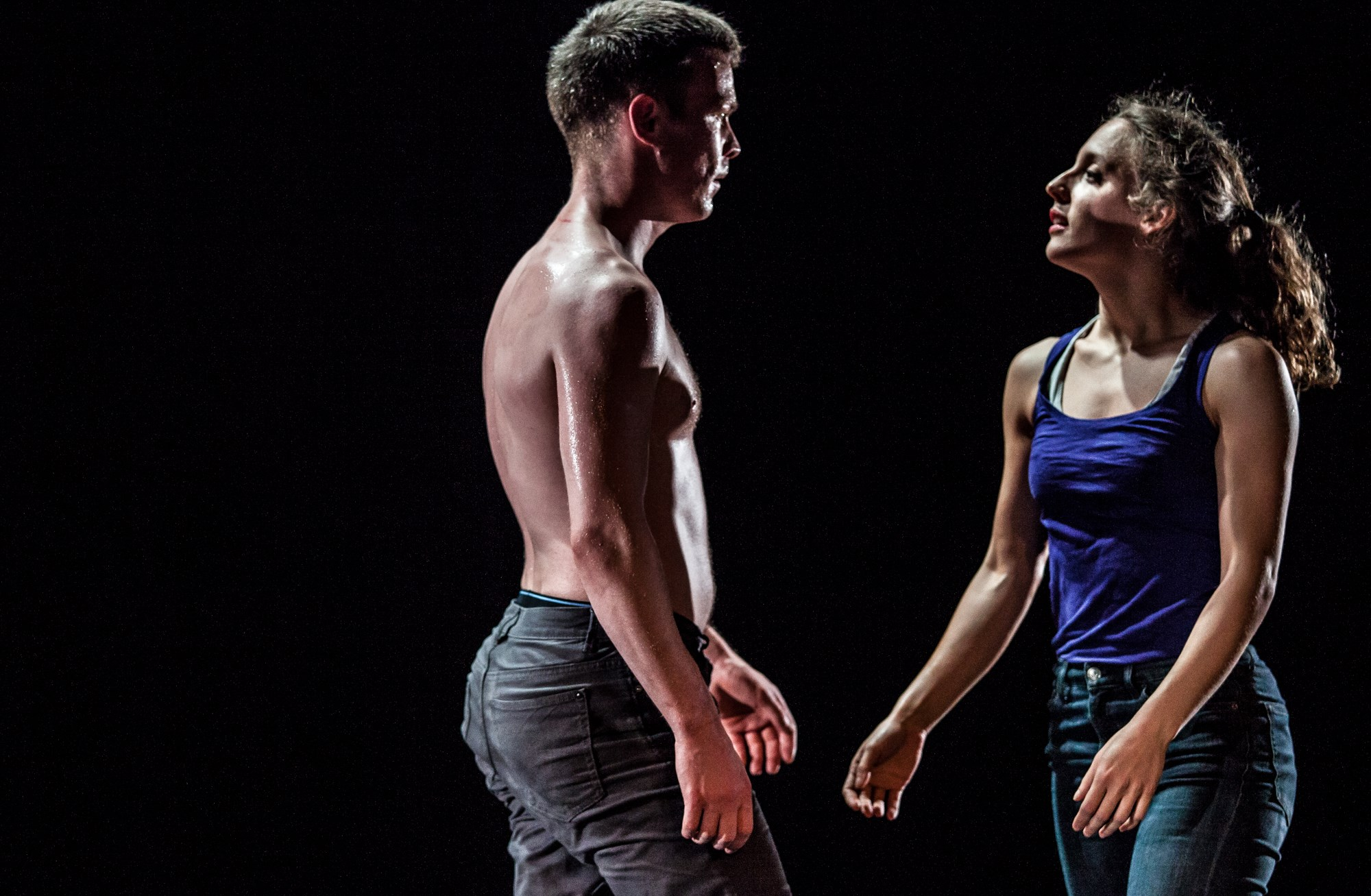 A male and female dancer walk towards each other. From Cuck, 2017, which was produced by Tinderbox. Photo Credit Ciaran Bagnall