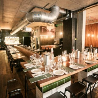 Industrial chic interior of Coppi Restaurant. Courtesy of Tourism NI